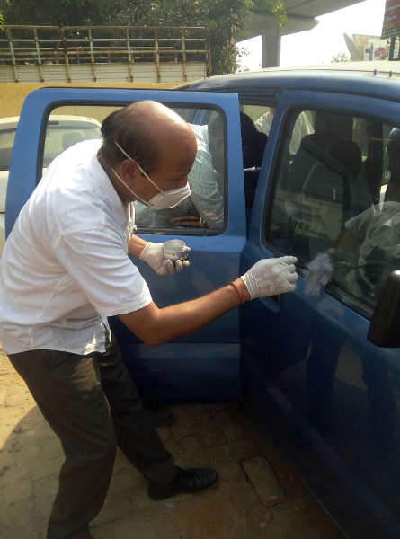 Forensic Science experts examining Arvind Kejriwal's car